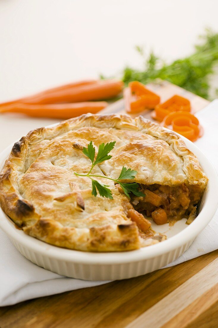 Beef and vegetable pie, a slice taken