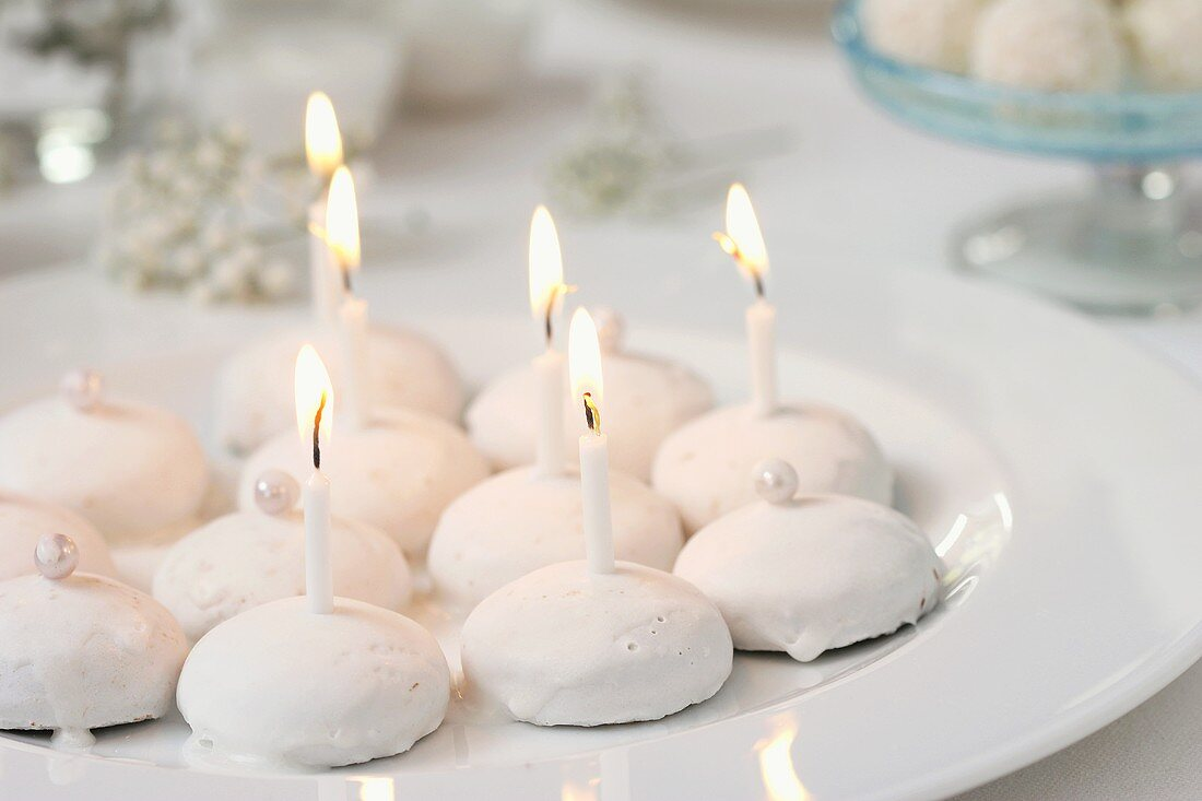 Pfeffernusse (peppernuts) with candles for 'Snowball party'