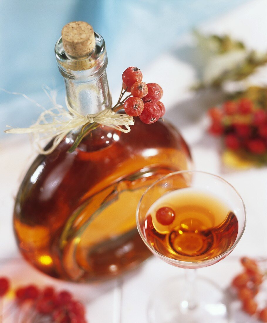 Rowanberry liqueur in bottle and glass