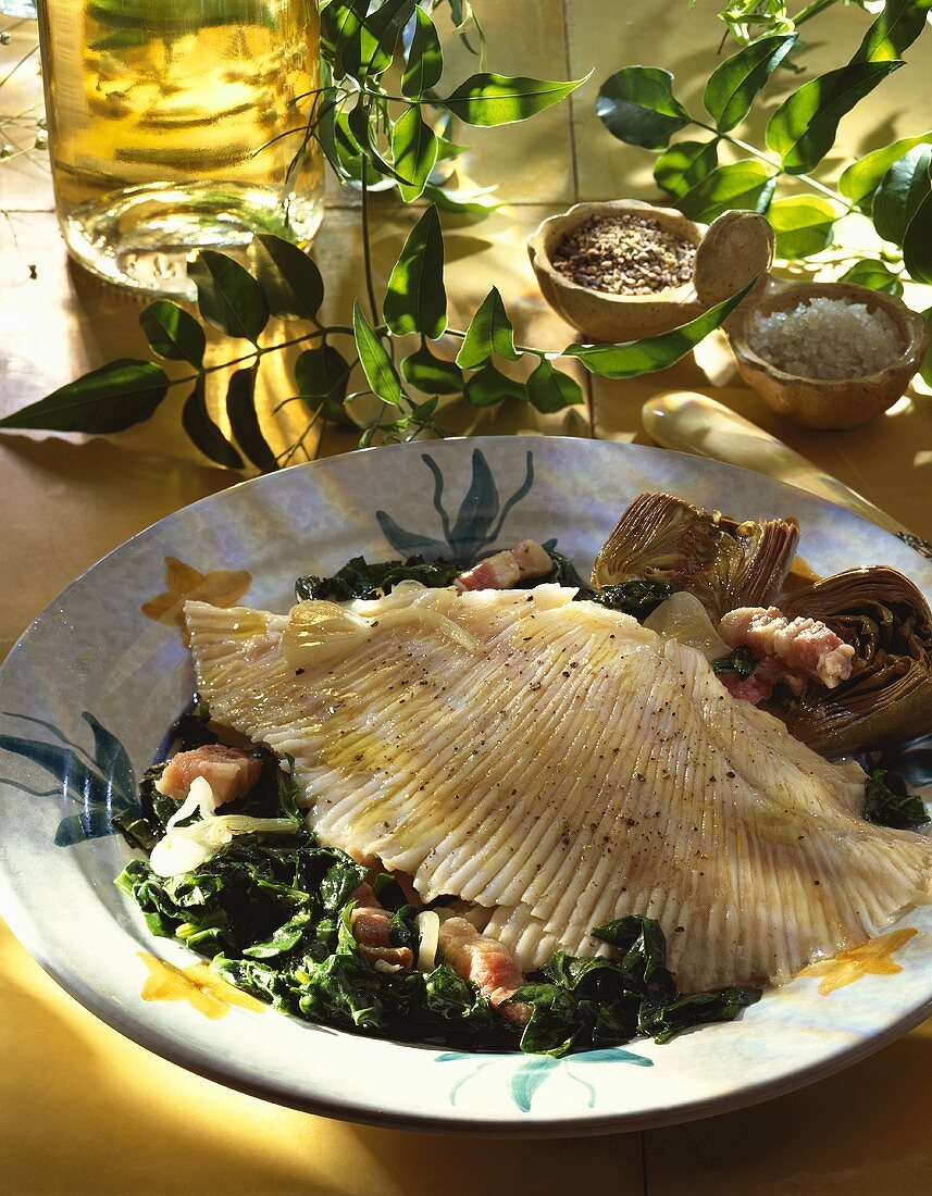 Skate wing with spinach and artichokes