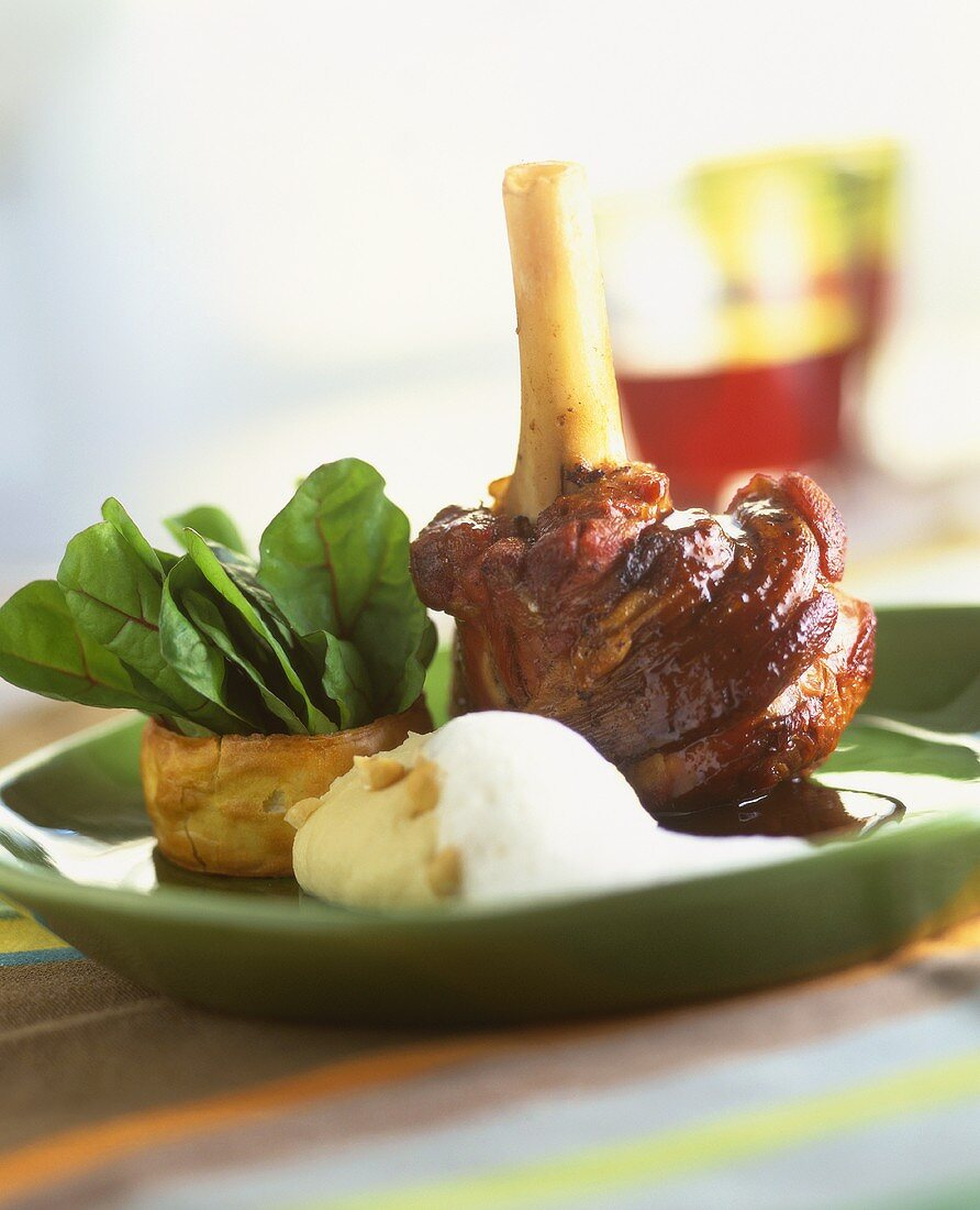 Leg of lamb with scorzonera puree and spinach salad