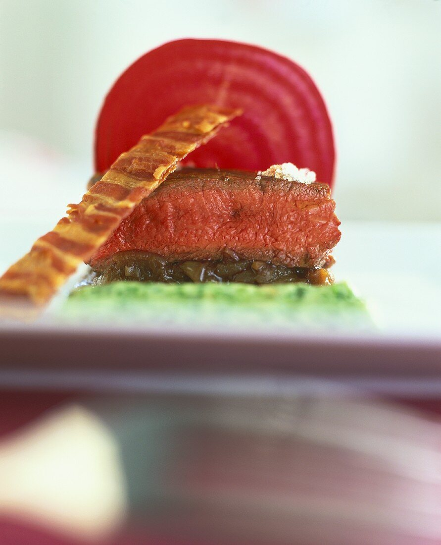 Tournedos with onion compote and beetroot crisps