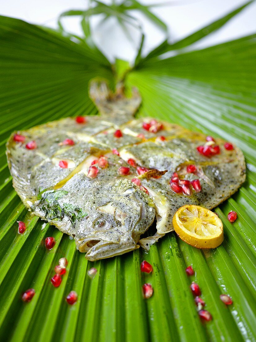 Fried sole with pomegranate seeds