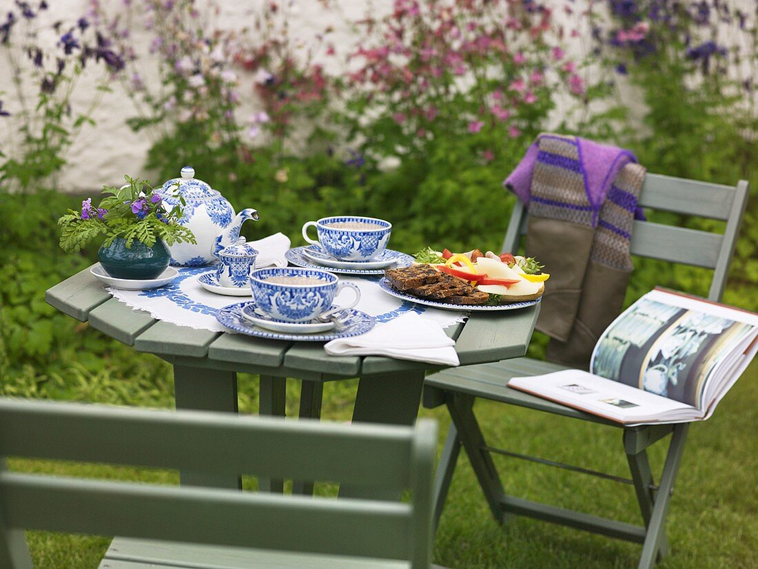 Table laid for afternoon tea in garden