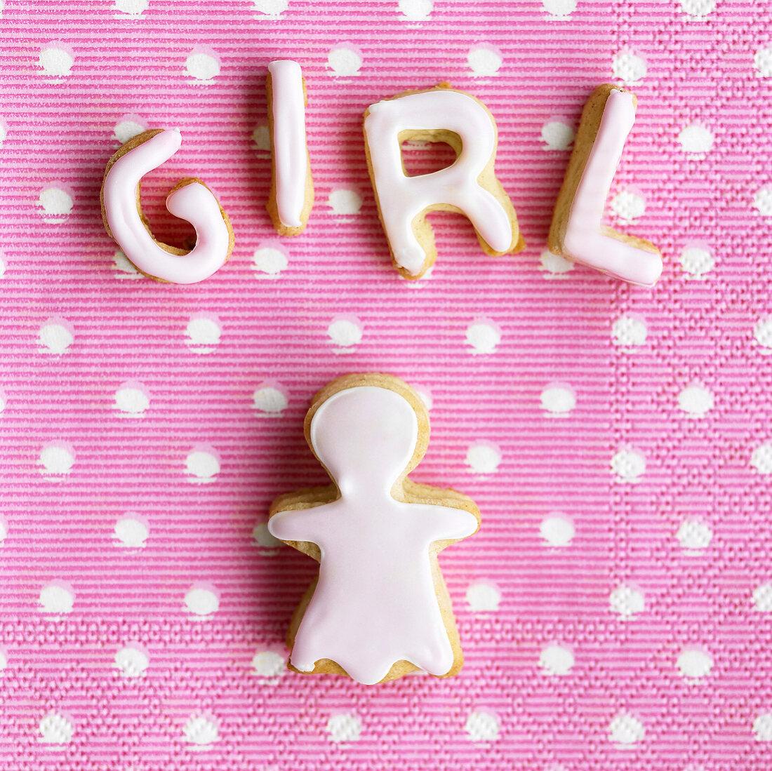 Baked letters spelling 'Girl' and girl figure on napkin