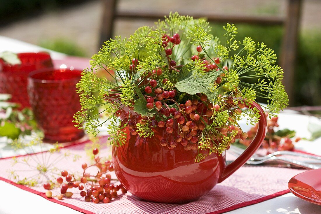 Posy of guelder rose berries and dill
