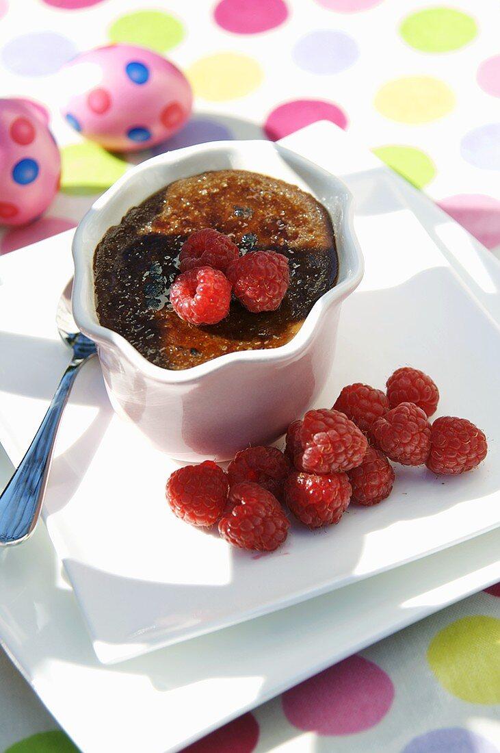 Baked chocolate cream with raspberries