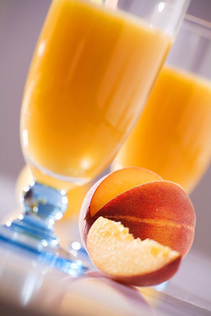 Peach nectar with peach (a slice removed)