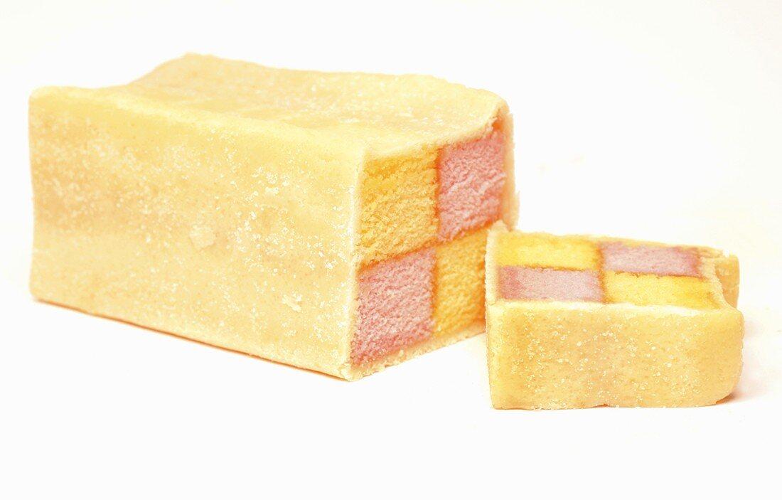 A Battenberg cake, a slice cut