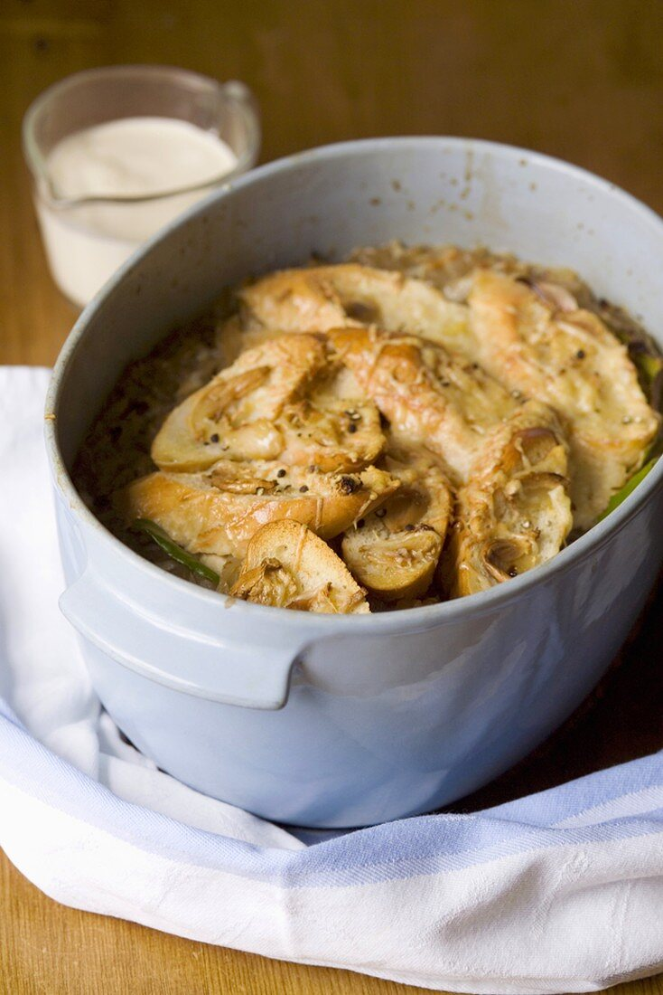 Onion soup with cheese croutes in pot