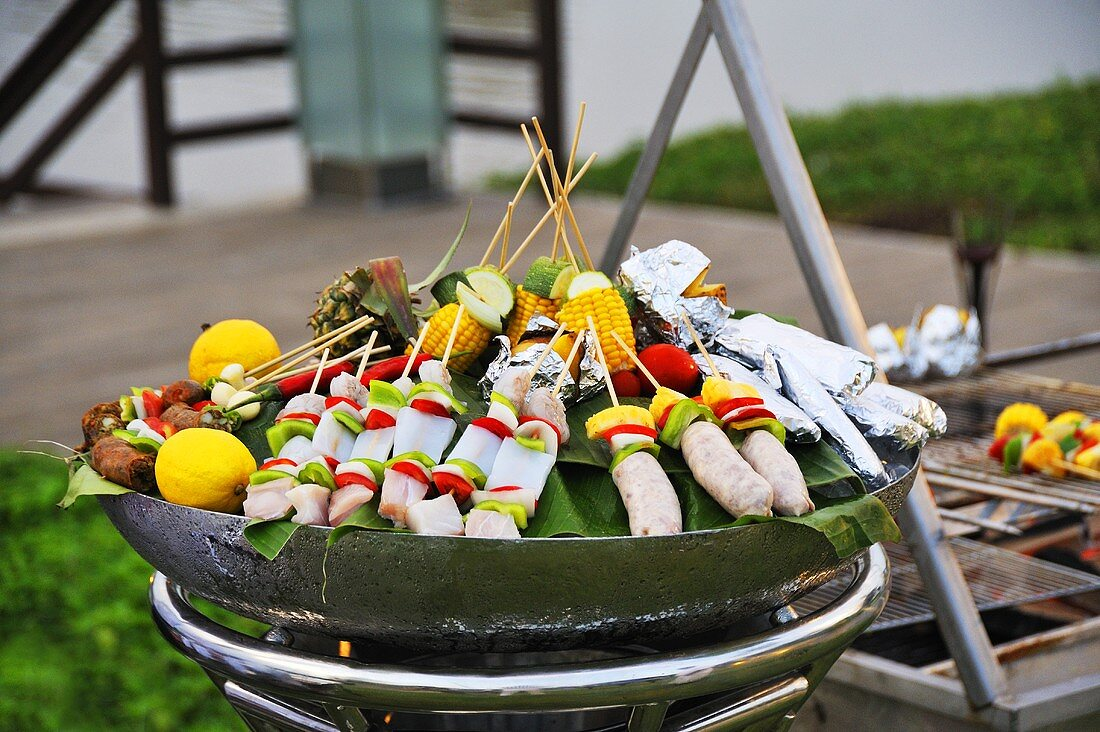 Barbeque kebabs with squid, fruit, vegetables and sausage