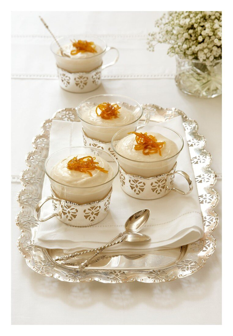 Baileys cheesecakes with candied orange zest