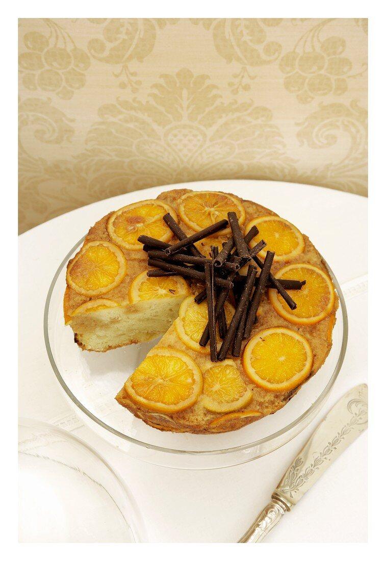 Marmalade cake with orange zest and chocolate rolls