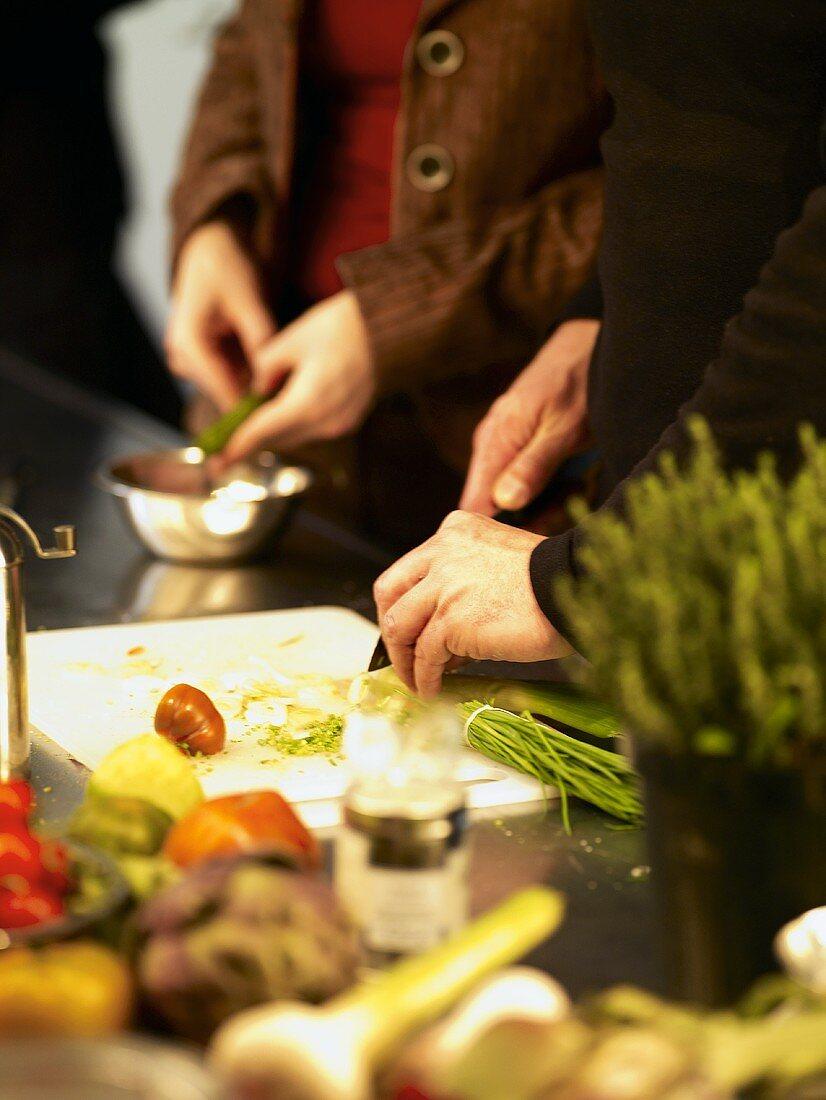 Two people preparing food