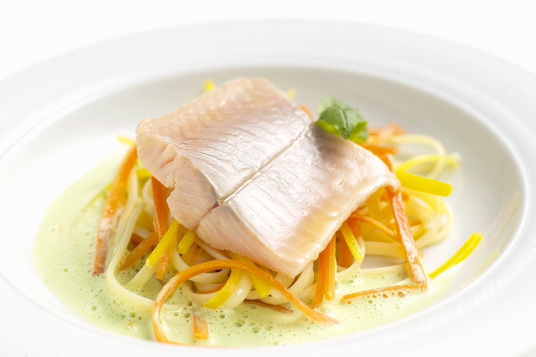 Poached salmon trout with vegetable noodles & basil sauce