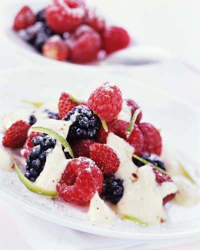 Fresh berries with frothy champagne sauce