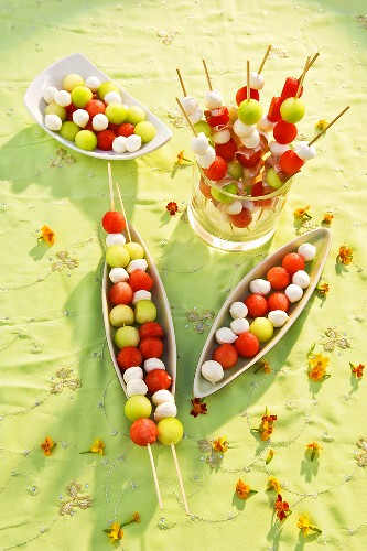 Melon and mozzarella balls on wooden skewers & in dishes