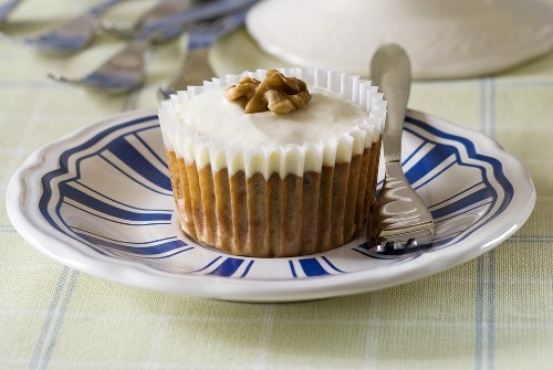 A carrot muffin with a walnut on top