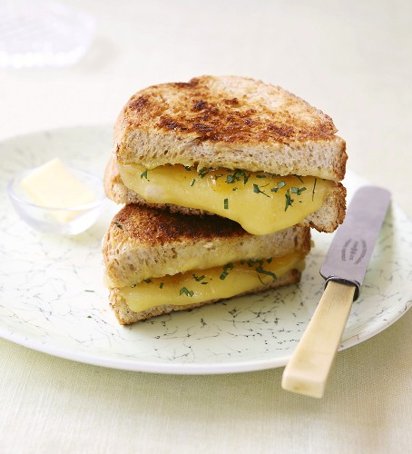Toasted cheese sandwiches with chutney and parsley