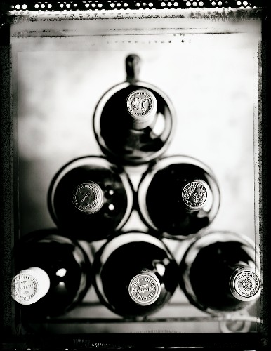 Wine bottles from Bordeaux in a wine rack (b/w positive)