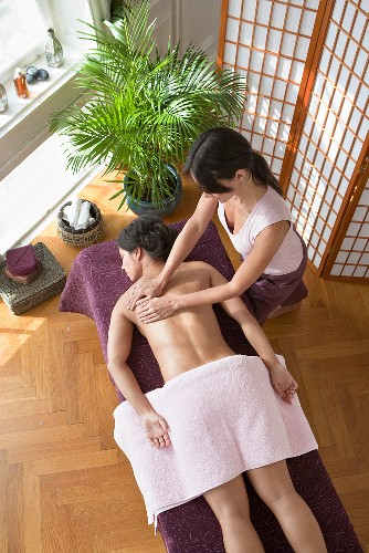 A woman having a back massage in a spa