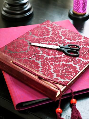 A photo album, scissors and a note book