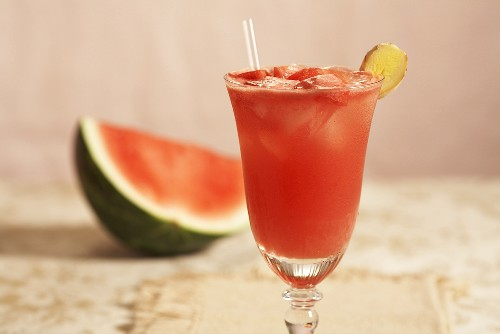 Watermelon Refresher in a Glass with Straw; Piece of Watermelon
