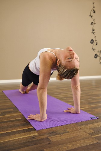 Young woman doing a yoga excercise