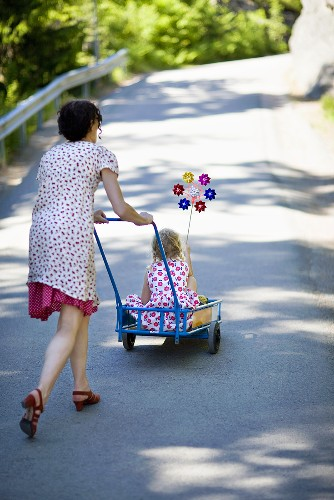 Women pushing a child in a stroller
