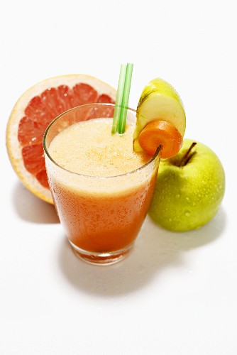 Multivitamin drink with grapefruit, carrot and apple