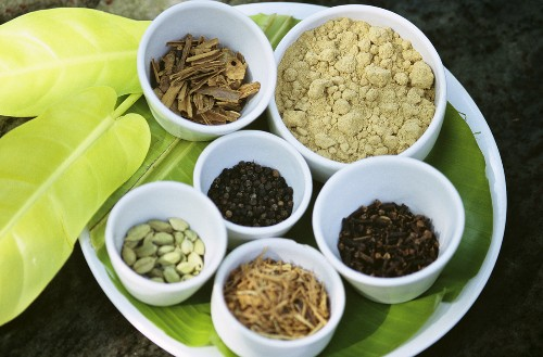 Ayurvedic spices in small bowls