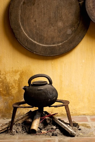Old tea kettle over a camp-fire