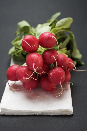 Radishes on linen cloth