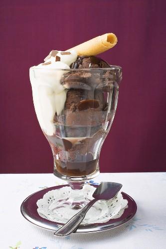 Sundae of chocolate ice cream, cream & wafer curl