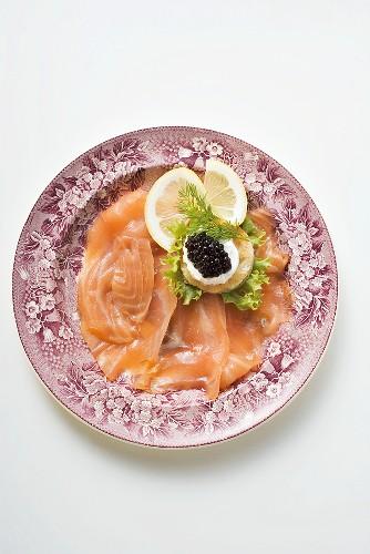 Smoked salmon with caviar and sour cream canapé