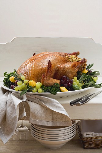 Stuffed turkey with herbs, grapes and patty pan squashes