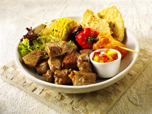 Grilled beef with vegetable kebab, salsa and flatbread