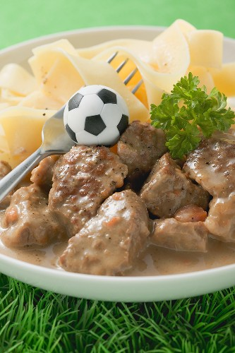 Zürcher Geschnetzeltes (veal dish) with pasta, football & fork