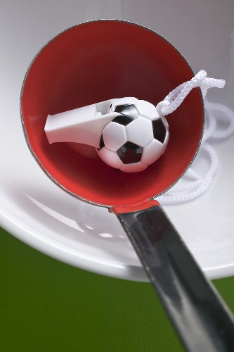 Football whistle in ladle