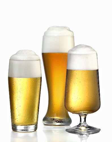 Three different glasses of beer