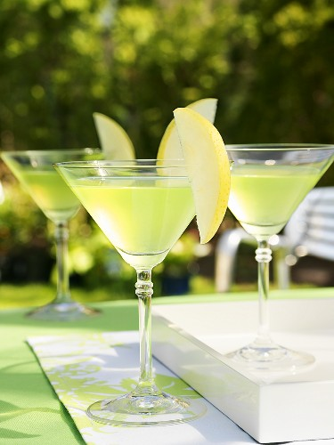 Apple Martinis on table out of doors