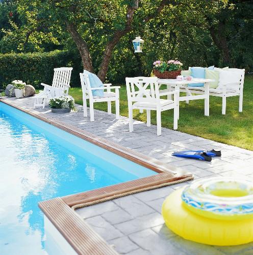 Swimming pool, rubber rings, garden furniture