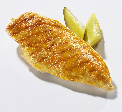 Grilled chicken breast fillet with gherkins