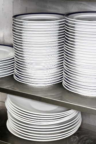 Piles of plates in professional kitchen