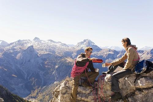 Austria, Salzburg County, Young couple taking a break