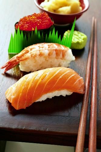 Nigiri-sushi and gunkan-maki with wasabi and ginger