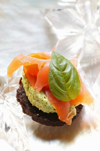 Pumpernickel rounds with salmon and basil