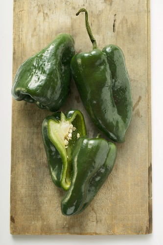 Green peppers (Poblano from Mexico) on chopping board