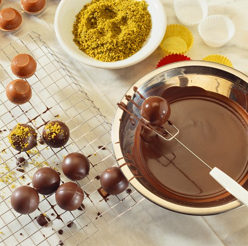 Home-made chocolates with chopped pistachios