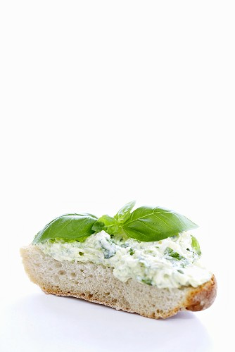 Courgette cream and basil on slice of white bread